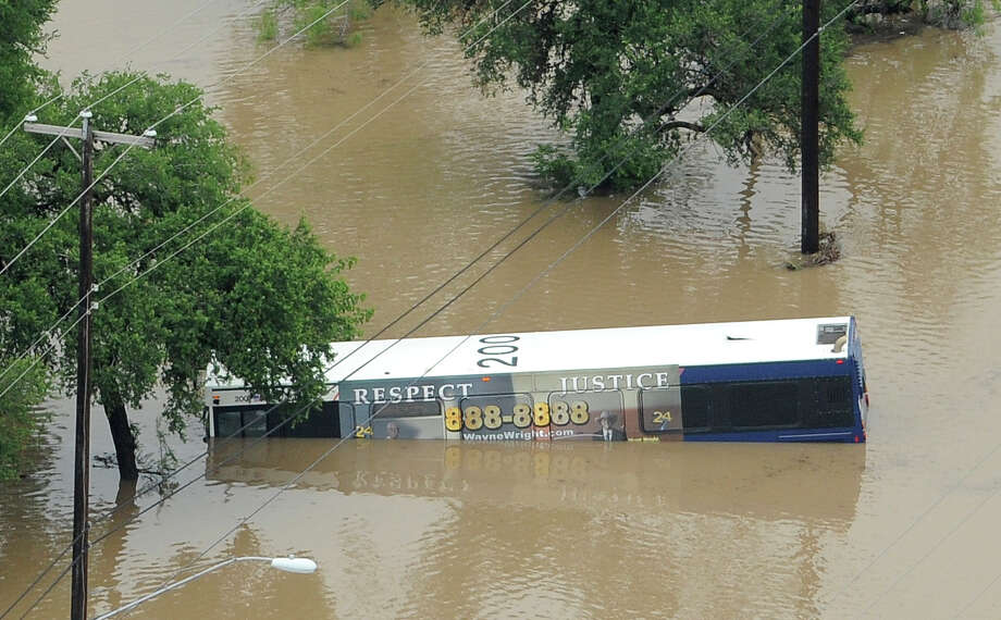 A bus is submerged on McCullough north of Basse after heavy rains in San Antonio on Saturday morning, May 25, 2013. Photo: Billy Calzada, San Antonio Express-News / San Antonio Express-News