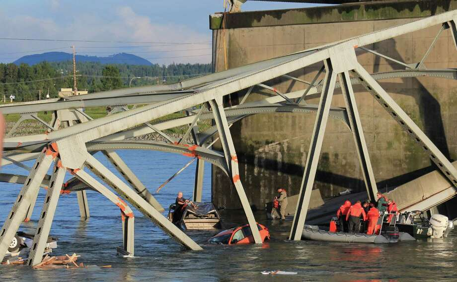 Rescue crews work the scene after an Interstate 5 bridge collapsed over the Skagit River between Mt. Vernon and Burlington on Thursday, May 23, 2013. Two cars and one travel trailer went in the water. There were no known fatalities. Photo: Francisco Rodriguez, Special To Seattlepi.com / special to seattlepi.com