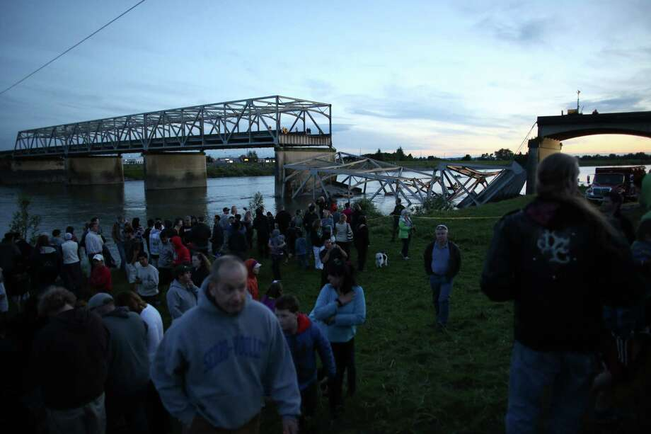 People gather at the scene after an Interstate 5 bridge collapsed over the Skagit River between Mt. Vernon and Burlington on Thursday, May 23, 2013. Two cars and one travel trailer went in the water. There were no known fatalities. Photo: JOSHUA TRUJILLO, SEATTLEPI.COM / SEATTLEPI.COM