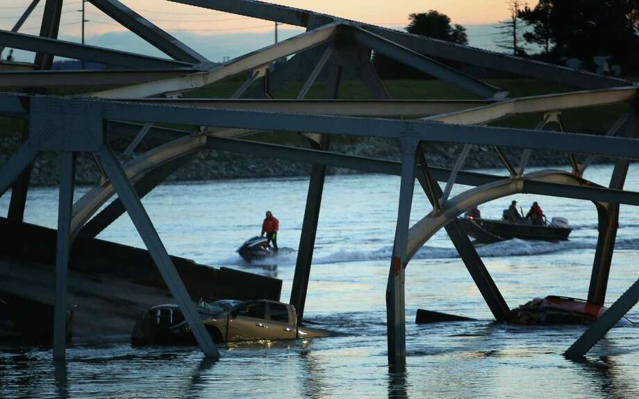 Rescue crews work after an Interstate 5 bridge collapsed over the Skagit River between Mt. Vernon and Burlington on Thursday, May 23, 2013. Two cars and one travel trailer went in the water. There were no known fatalities. Photo: JOSHUA TRUJILLO, SEATTLEPI.COM / SEATTLEPI.COM