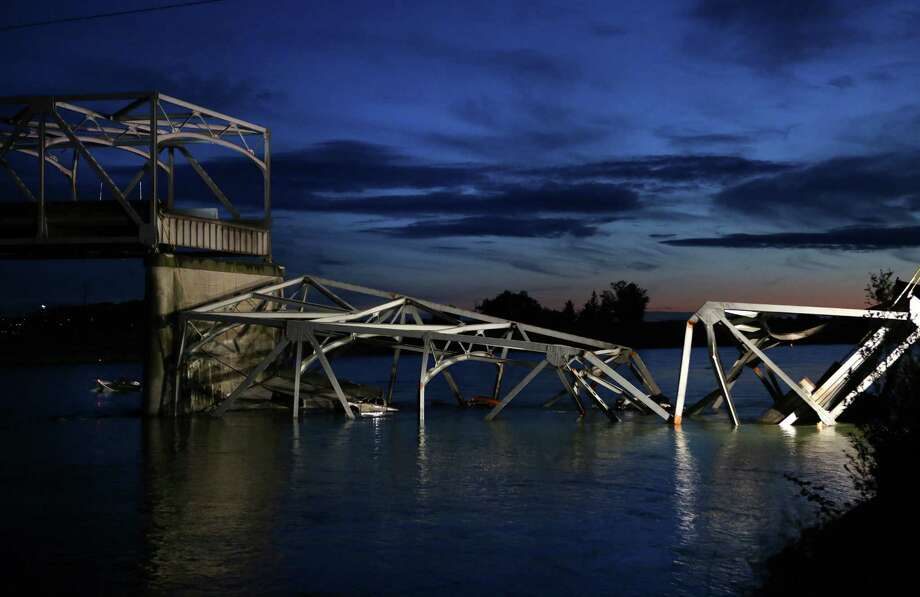The sun sets after an Interstate 5 bridge collapsed over the Skagit River between Mt. Vernon and Burlington on Thursday, May 23, 2013. Two cars and one travel trailer went in the water. There were no known fatalities. Photo: JOSHUA TRUJILLO, SEATTLEPI.COM / SEATTLEPI.COM