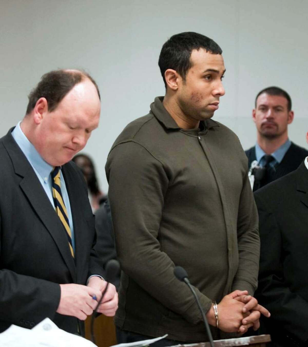 Defense Attorney, Daniel Ford, left, represents defendent and Probation Officer, Alphah East, center, during his arraignment in Norwalk, Conn. Superior Court Tuesday Jan. 12, 2009. East is held in connection to bribery while working as a Probation Officer and was arrested by Norwalk police Monday night on charges of collecting $13,500 in bribes over the past six months from the father of one of the young women he monitored, according to authorities