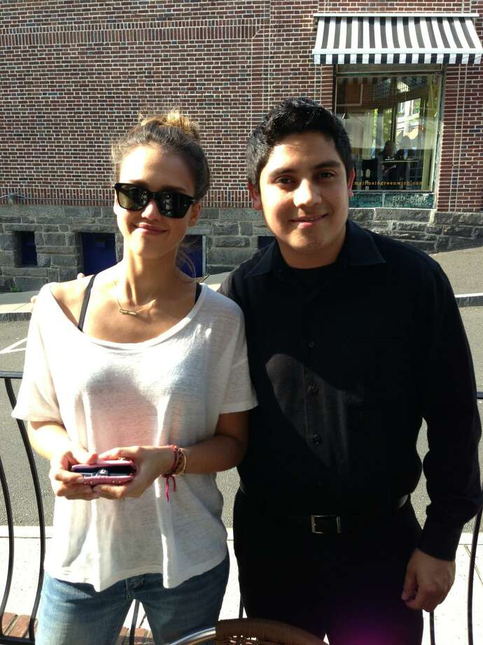 Actress Jessica Alba poses with Elias Pineda of Mediterraneo restaurant on Greenwich Avenue while having a late lunch with her mom on the patio on Monday. Photo: Contributed Photo