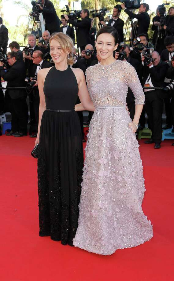 Actors Ludivine Sagnier and Zhang Ziyi arrive on the red carpet for the screening of Venus in Fur at the 66th international film festival, in Cannes, southern France, Saturday, May 25, 2013. Photo: AP