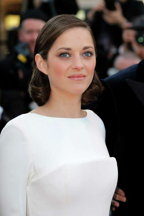 Actress Marion Cotillard arrives for the screening of The Immigrant at the 66th international film festival, in Cannes, southern France, Friday, May 24, 2013. Photo: AP