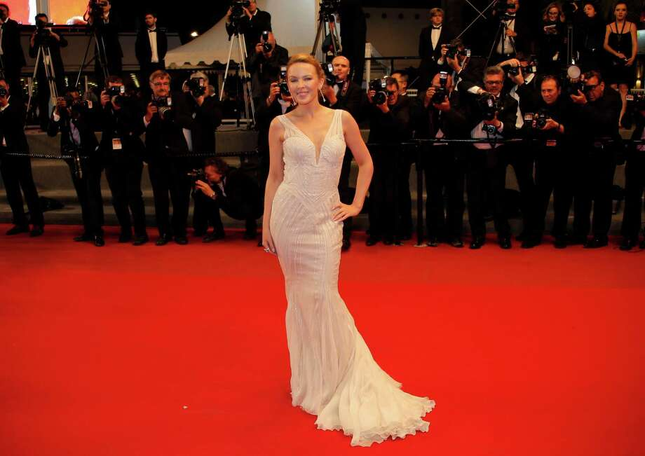 Singer Kylie Minogue arrives on the red carpet for the screening of The Great Beauty at the 66th international film festival, in Cannes, southern France, Tuesday, May 21, 2013. Photo: AP