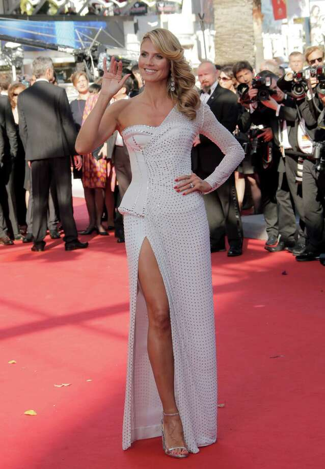 Model Heidi Klum arrives for the screening of Nebraska at the 66th international film festival, in Cannes, southern France, Thursday, May 23, 2013. Photo: AP