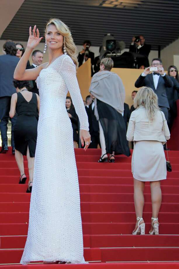 Model Heidi Klum poses for photographers as she arrives for the screening of Nebraska at the 66th international film festival, in Cannes, southern France, Thursday, May 23, 2013. Photo: AP