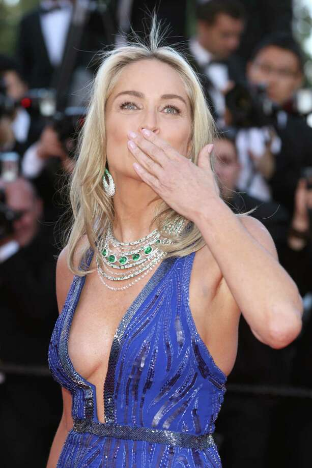 Actress Sharon Stone blows a kiss to photographers as she arrives for the screening of Behind the Candelabra at the 66th international film festival, in Cannes, southern France, Tuesday, May 21, 2013. Photo: AP