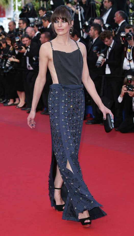 Actress Milla Jovovich arrives for the screening of Behind the Candelabra at the 66th international film festival, in Cannes, southern France, Tuesday, May 21, 2013. Photo: AP