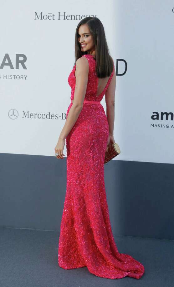 Model Irina Shayk arrives at amfAR Cinema Against AIDS benefit at the Hotel du Cap-Eden-Roc, during the 66th international film festival, in Cap d'Antibes, southern France, Thursday, May 23, 2013. Photo: AP