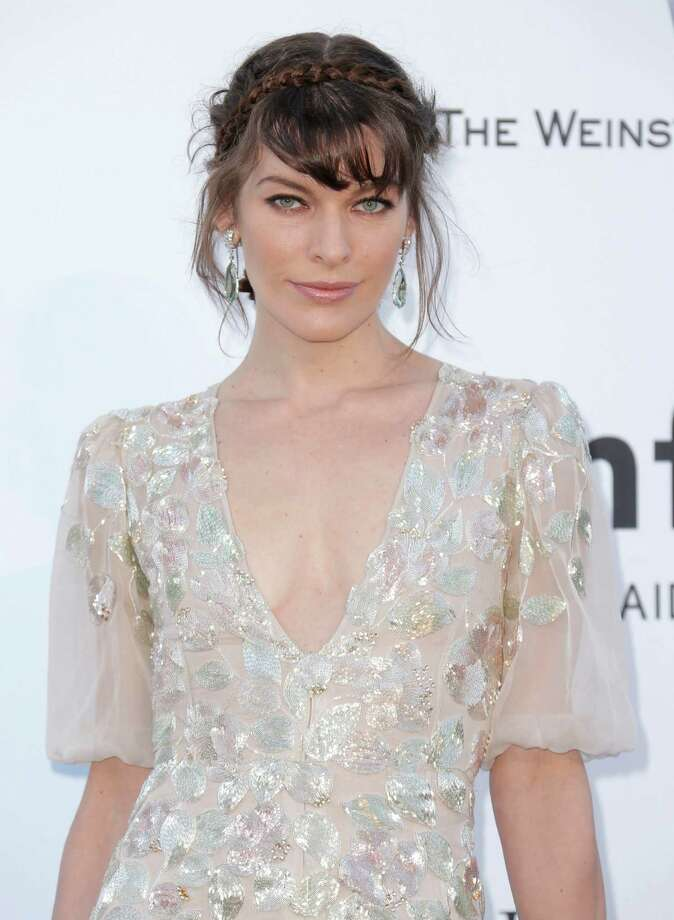 Actress Milla Jovovich arrives at amfAR Cinema Against AIDS benefit at the Hotel du Cap-Eden-Roc, during the 66th international film festival, in Cap d'Antibes, southern France, Thursday, May 23, 2013. Photo: AP