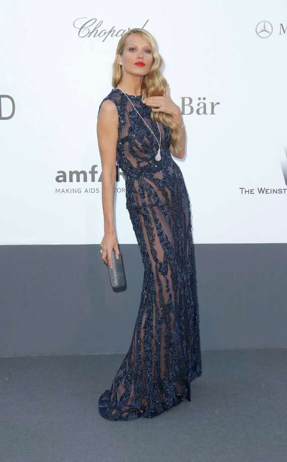 Model Petra Nemcova arrives at amfAR Cinema Against AIDS benefit at the Hotel du Cap-Eden-Roc, during the 66th international film festival, in Cap d'Antibes, southern France, Thursday, May 23, 2013. Photo: AP