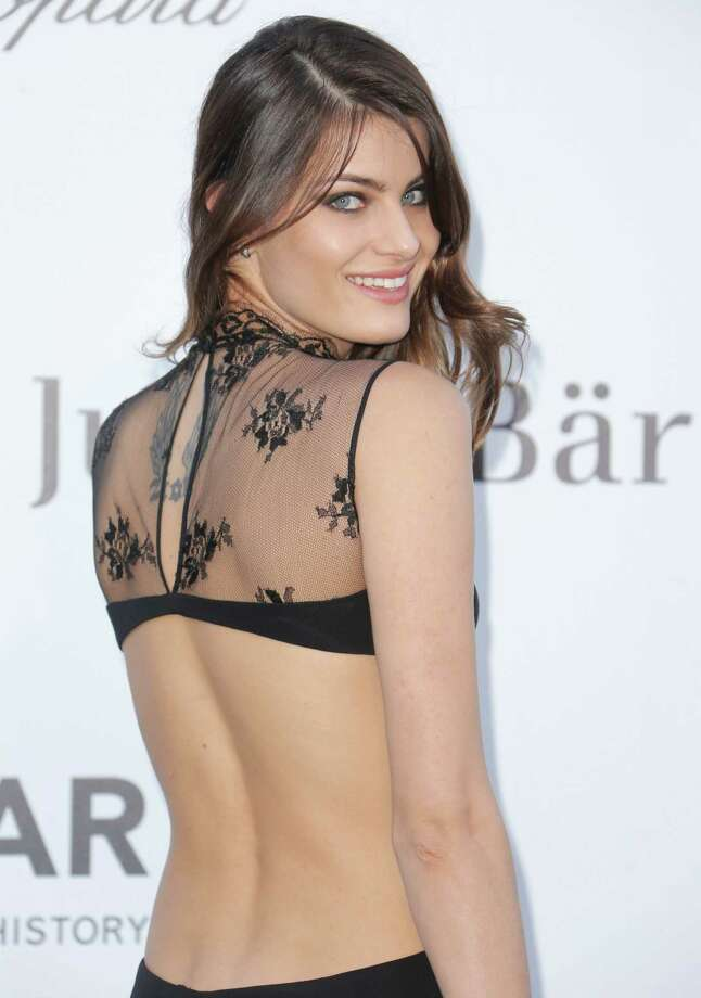 Model Isabeli Fontana arrives at amfAR Cinema Against AIDS benefit at the Hotel du Cap-Eden-Roc, during the 66th international film festival, in Cap d'Antibes, southern France, Thursday, May 23, 2013. Photo: AP
