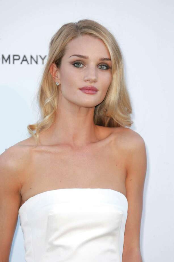 Actress Rosie Huntington-Whiteley arrives at amfAR Cinema Against AIDS benefit at the Hotel du Cap-Eden-Roc, during the 66th international film festival, in Cap d'Antibes, southern France, Thursday, May 23, 2013. Photo: AP