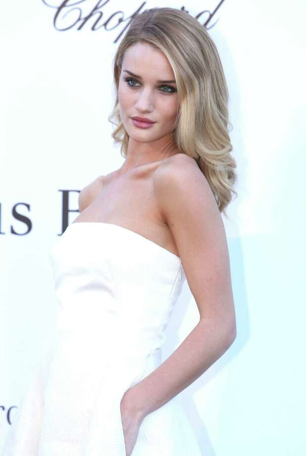 Actress Rosie-Huntington-Whiteley arrives at amfAR Cinema Against AIDS benefit at the Hotel du Cap-Eden-Roc, during the 66th international film festival, in Cap d'Antibes, southern France, Thursday, May 23, 2013. Photo: AP