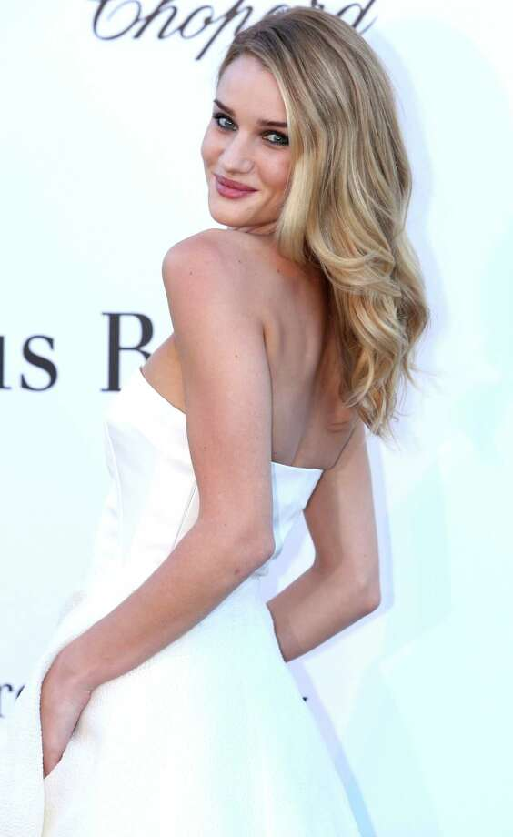 Model Rosie Huntington-Whiteley arrives at amfAR Cinema Against AIDS benefit at the Hotel du Cap-Eden-Roc, during the 66th international film festival, in Cap d'Antibes, southern France, Thursday, May 23, 2013. Photo: AP
