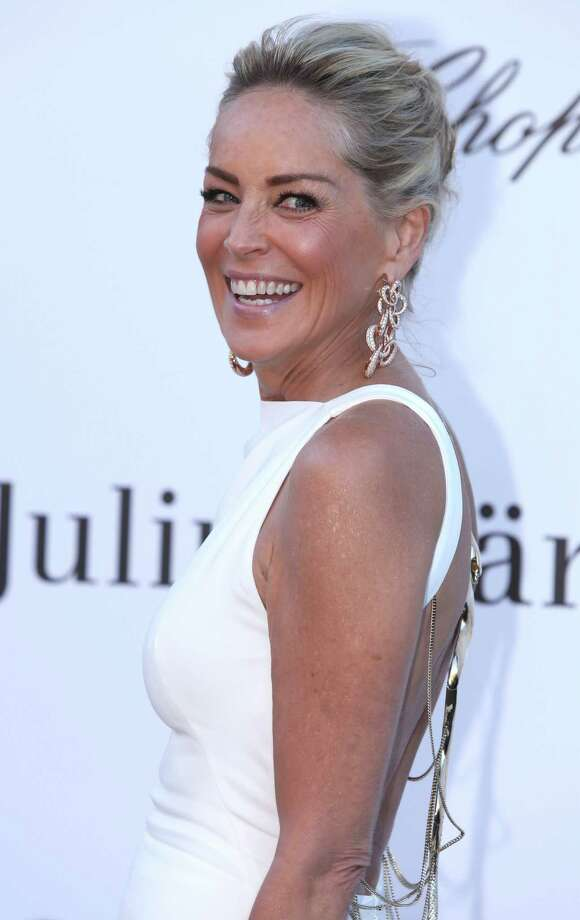 Actress Sharon Stone arrives at amfAR Cinema Against AIDS benefit at the Hotel du Cap-Eden-Roc, during the 66th international film festival, in Cap d'Antibes, southern France, Thursday, May 23, 2013. Photo: AP