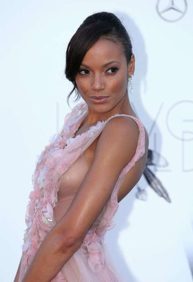 Model Selita Ebanks arrives at amfAR Cinema Against AIDS benefit at the Hotel du Cap-Eden-Roc, during the 66th international film festival, in Cap d'Antibes, southern France, Thursday, May 23, 2013. Photo: AP