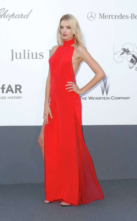 Model Lily Donaldson arrives at amfAR Cinema Against AIDS benefit at the Hotel du Cap-Eden-Roc, during the 66th international film festival, in Cap d'Antibes, southern France, Thursday, May 23, 2013. Photo: AP