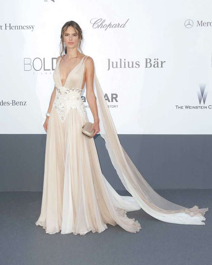 Model Alessandra Ambrosio arrives at amfAR Cinema Against AIDS benefit at the Hotel du Cap-Eden-Roc, during the 66th international film festival, in Cap d'Antibes, southern France, Thursday, May 23, 2013. Photo: AP