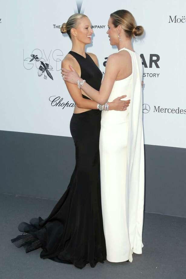 Models Karolina Kurkova and Eva Herzigova arrive at amfAR Cinema Against AIDS benefit at the Hotel du Cap-Eden-Roc, during the 66th international film festival, in Cap d'Antibes, southern France, Thursday, May 23, 2013. Photo: AP