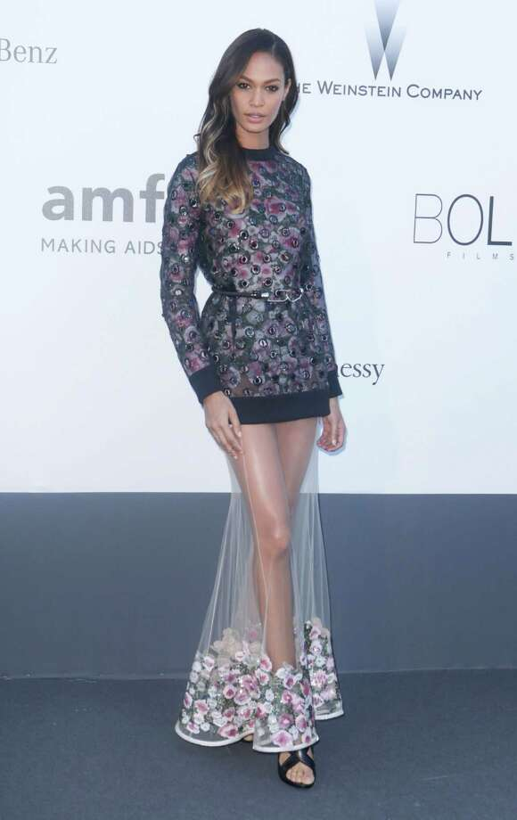 Model Joan Smalls arrives at amfAR Cinema Against AIDS benefit at the Hotel du Cap-Eden-Roc, during the 66th international film festival, in Cap d'Antibes, southern France, Thursday, May 23, 2013. Photo: AP