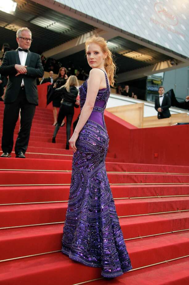 Actress Jessica Chastain poses for photographers as she arrives for the screening of All Is Lost at the 66th international film festival, in Cannes, southern France, Wednesday, May 22, 2013. Photo: AP