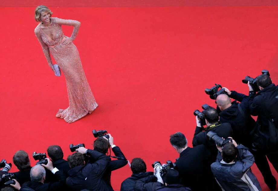 Model Petra Nemcova poses for photographers as she arrives for the screening of All Is Lost at the 66th international film festival, in Cannes, southern France, Wednesday, May 22, 2013. Photo: AP