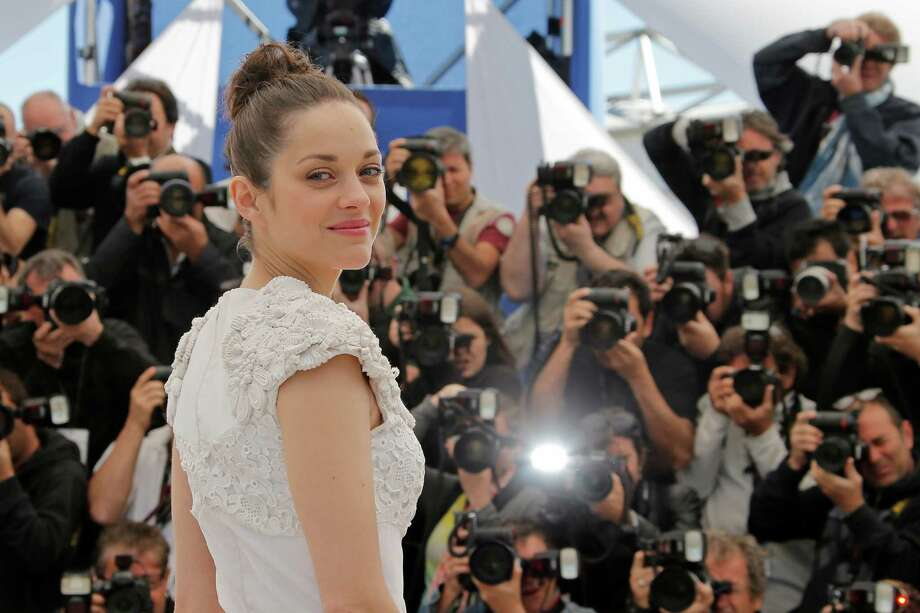 Actress Marion Cotillard poses for photographers during a photo call for the film The Immigrant at the 66th international film festival, in Cannes, southern France, Friday, May 24, 2013. Photo: AP