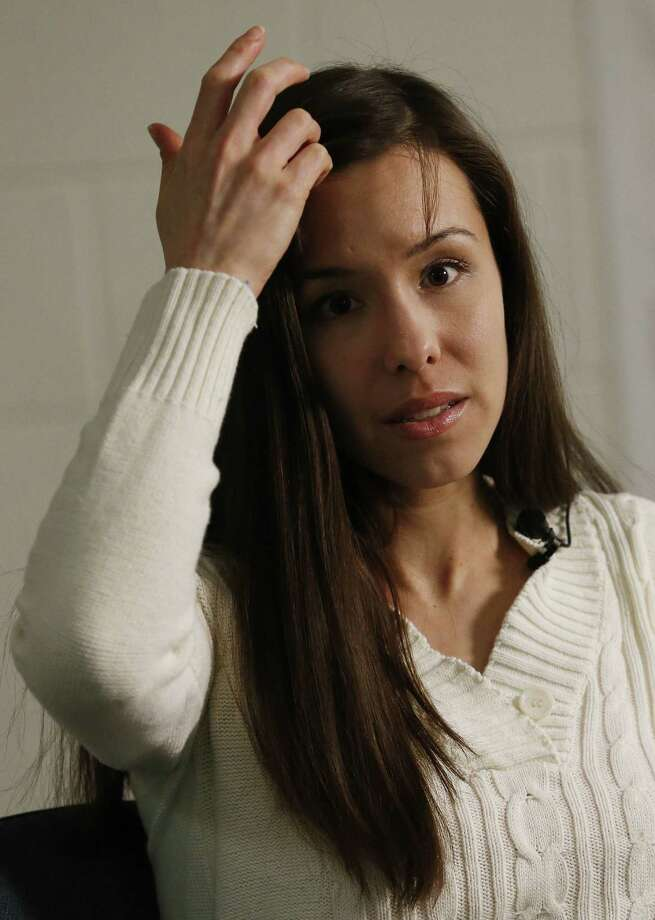 Convicted killer Jodi Arias moves her hair away from her forehead as she speaks during an interview at the Maricopa County Estrella Jail on Tuesday, May 21, 2013, in Phoenix.  Arias was convicted recently of killing her former boyfriend Travis Alexander in his suburban Phoenix home back in 2008, made a plea in court on Tuesday for life in prison, instead of execution, saying she can contribute to society if allowed to live. Photo: AP