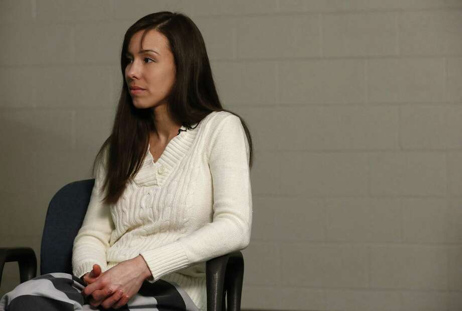 Convicted killer Jodi Arias listens to a question asked of her before speaking during an interview at the Maricopa County Estrella Jail on Tuesday, May 21, 2013, in Phoenix.  Arias was convicted recently of killing her former boyfriend Travis Alexander in his suburban Phoenix home back in 2008, made a plea for life in prison, instead of execution, saying she can contribute to society if allowed to live. Photo: AP