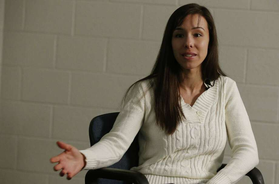 Convicted killer Jodi Arias gestures as she speaks during an interview at the Maricopa County Estrella Jail on Tuesday, May 21, 2013, in Phoenix.  Arias was convicted recently of killing her former boyfriend Travis Alexander in his suburban Phoenix home back in 2008, made a plea for life in prison, instead of execution, saying she can contribute to society if allowed to live. Photo: AP