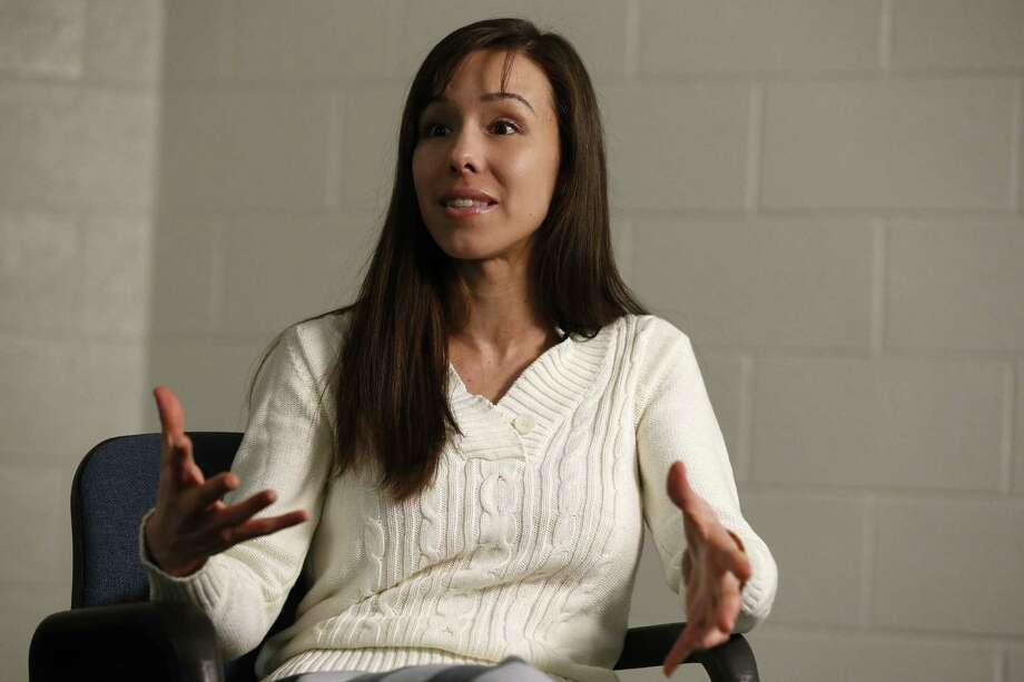 Convicted killer Jodi Arias emphasizes a point while answering a question during an interview at the Maricopa County Estrella Jail on Tuesday, May 21, 2013, in Phoenix.  Arias was convicted recently of killing her former boyfriend Travis Alexander in his suburban Phoenix home back in 2008, and could face the possibility of the death penalty as the sentencing phase of her trial continues. Photo: AP