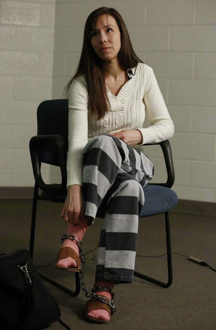 Convicted killer Jodi Arias pauses for a moment during an interview at the Maricopa County Estrella Jail on Tuesday, May 21, 2013, in Phoenix. Arias was convicted recently of killing her former boyfriend Travis Alexander in his suburban Phoenix home back in 2008, made a plea in court Tuesday for life in prison, instead of execution, saying she can contribute to society if allowed to live.