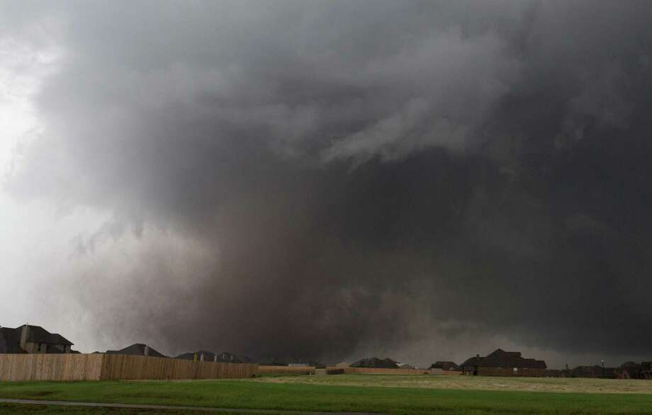 A tornado moves past homes in Moore, Okla. on Monday, May 20, 2013. A monstrous tornado roared through the Oklahoma City suburbs, flattening entire neighborhoods with winds up to 200 mph, setting buildings on fire and landing a direct blow on an elementary school. Photo: AP