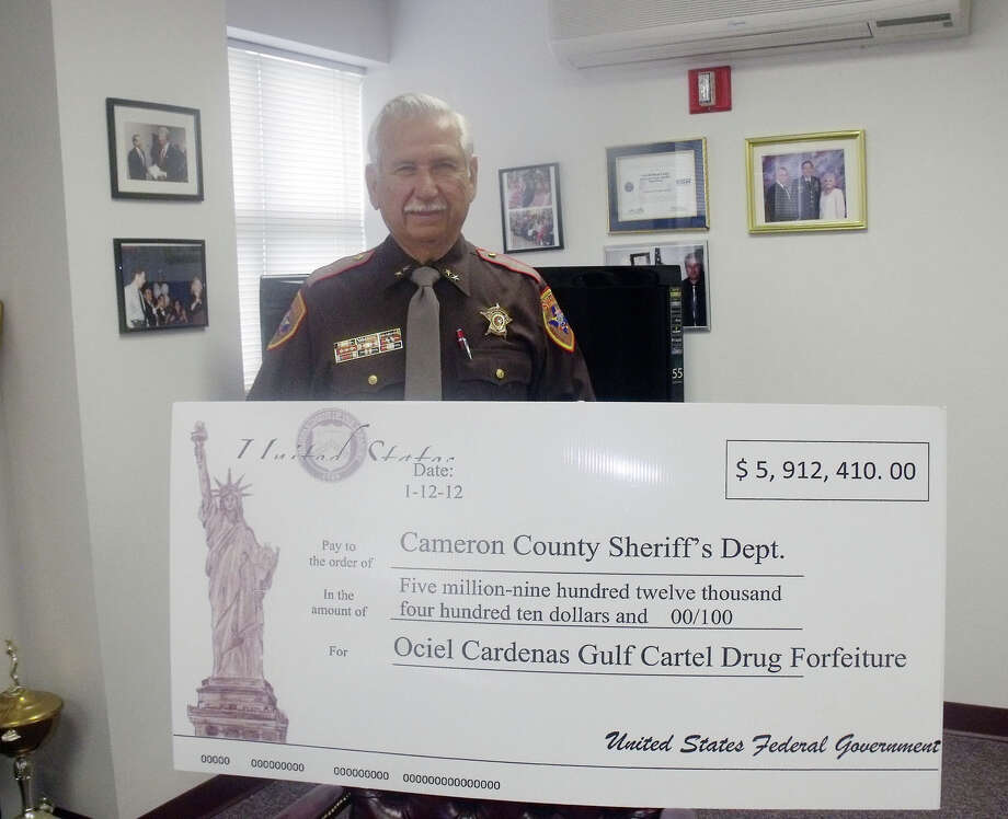 Osiel Cardenas Guillen This is a photo of Sheriff Omar Lucio in Cameron  County accepting his department's $5.9 million share of federal  forfeiture proceeds from the Osiel Cardenas case in 2012.  It is part of  an estimated $29 million out of $50 million in funds that Cardenas,   former leader of Mexico's powerful Gulf Cartel,  agreed to forfeit as  part of his 2010 sentencing agreement. Photo: Courtesy Of The Cameron County Sheriff's Office