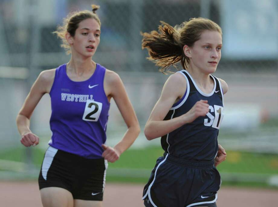Staples' Hannah Debalsi wins the girls 3200 meter run, edging out Westhill's Claire Howlett at the FCIAC Track and Field Championships at Danbury High on Tuesday. Photo: Tyler Sizemore / The News-Times