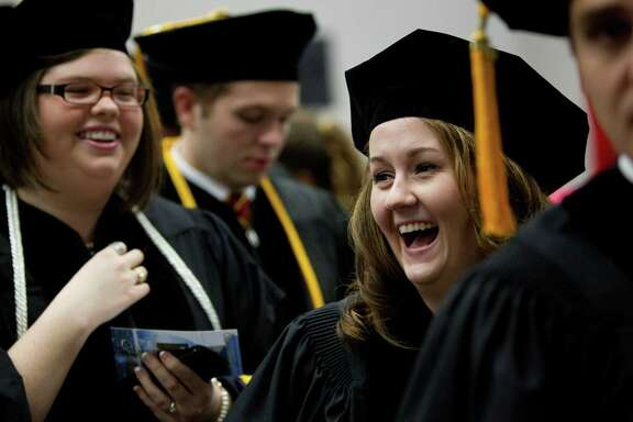 Loren Jones laughs with her classmates before Saturday graduation ceremonies at the South Texas College of Law at the George R. Brown Convention Center. She hopes to practice family law, working with children and victims of domestic abuse.