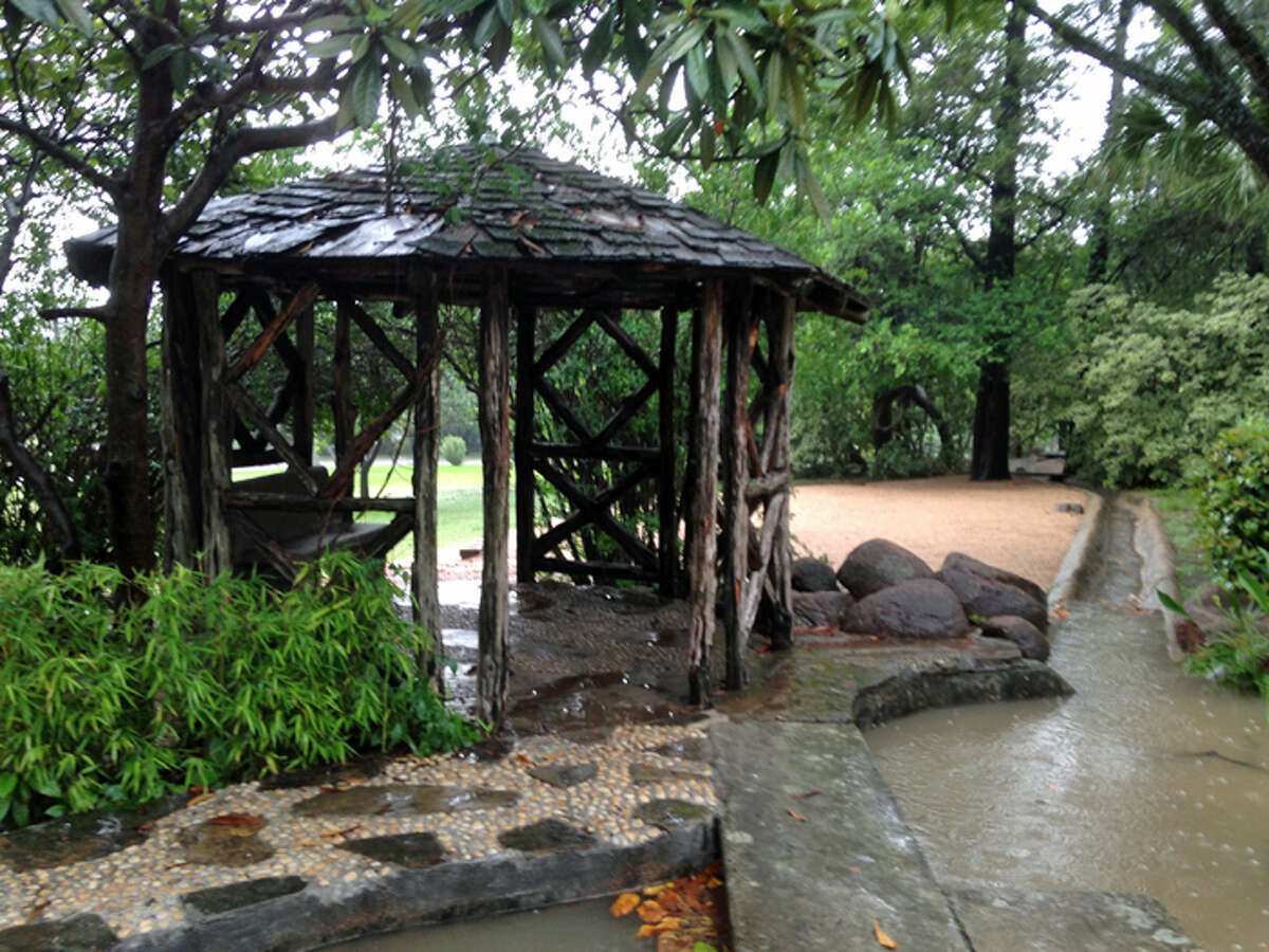 A small gazebo offers refuge from the rain at the McNay Art Museum, Saturday, May 25, 2013.