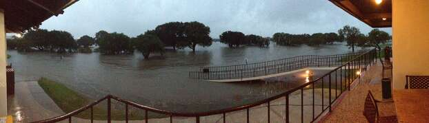 View of Olmos Golf Course clubhouse during the height of the flooding on Saturday, May 25, 2013. Photo: Courtesy Of Jim Roschek
