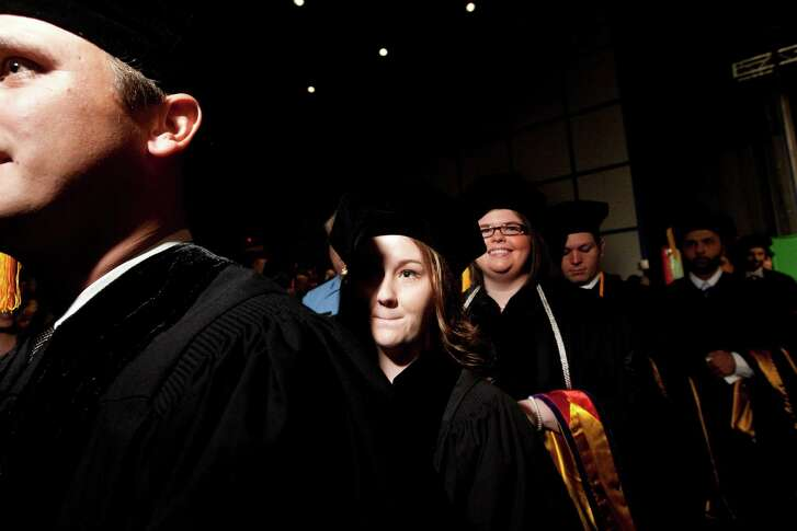 Loren Jones walks into the graduation ceremony before graduating from the South Texas College of Law at the George R. Brown Convention Center Saturday, May 25, 2013, in Houston.