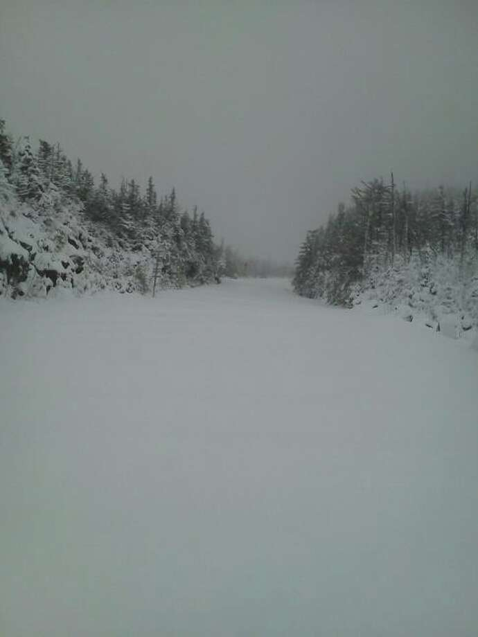 Snow blankets the Whiteface Memorial Highway on Saturday in Lake Placid. (Courtesy Amy Osterhaudt)