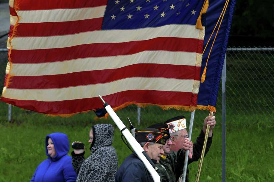Members of East Greenbush VFW Post 7338 lead the annual East Greenbush Memorial Day Parade on Saturday May 25, 2013 in East Greenbush, N.Y. (Michael P. Farrell/Times Union) Photo: Michael P. Farrell