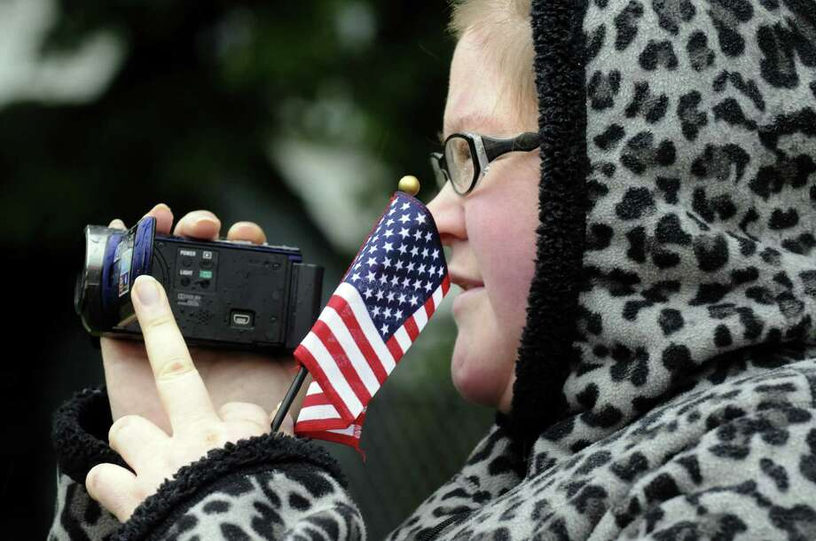 Holly Kuhn video tapes the annual East Greenbush Memorial Day Parade on Saturday May 25, 2013 in East Greenbush, N.Y. (Michael P. Farrell/Times Union) Photo: Michael P. Farrell