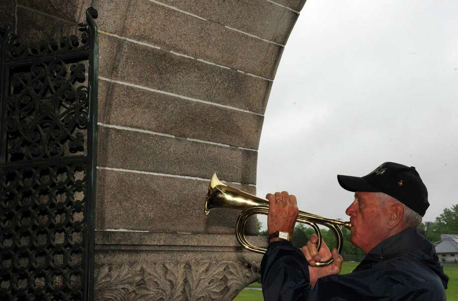 "Dick Porter plays ""Taps"" during The Veterans of Lansingburgh, Inc. Memorial Day weekend ceremony at Oakwood Cemetery on Saturday, May 25, 2013 in Troy, N.Y. (Michael P. Farrell/Times Union) Photo: Michael P. Farrell"