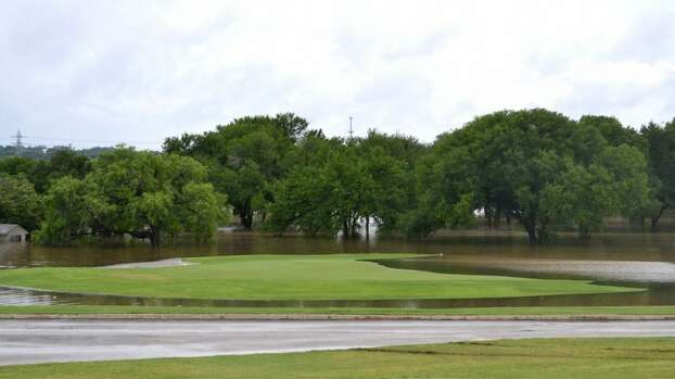 A green is the only dry place on the course at Olmos Basin Golf Course after heavy rains hit the city on Saturday, May 25, 2013. Photo: Picasa, Glenda Wolin / For The San Antonio Express-News