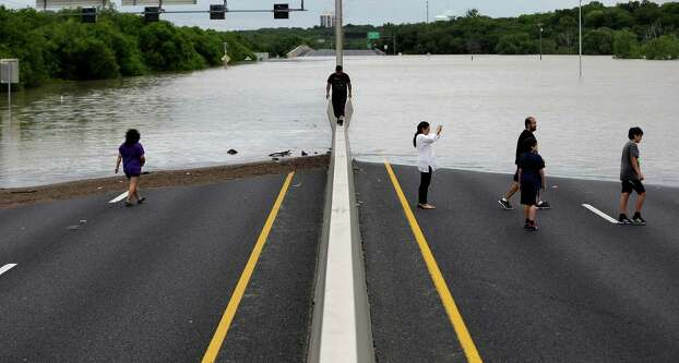 Flood waters cover eight lanes of Highway 281, Saturday, May 25, 2013, in San Antonio.  The San Antonio International Airport by Saturday afternoon had recorded nearly 10 inches of rain since midnight.  (AP Photo/Eric Gay) Photo: Eric Gay, Associated Press / AP