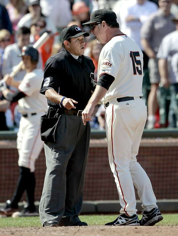 Bruce Bochy argues a call with umpire Alfonso Marquez at AT&T Park. The new replay proposal has glaring flaws. Photo: Michael Macor, The Chronicle