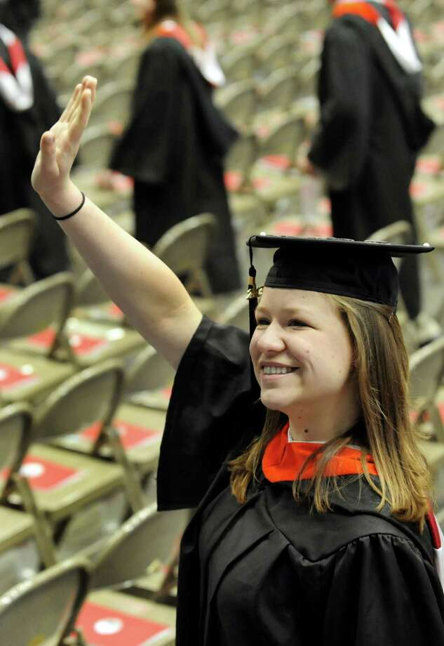 Graduate Paulina Bukanowska waves to loved ones during RPI college commencement on Saturday, May 25, 2013, at Rensselaer Polytechnic Institute in Troy, N.Y. (Cindy Schultz / Times Union) Photo: Cindy Schultz / 10022129A